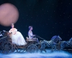 Cinderella on a horse-drawn carriage, shrouded in moonlight and stars. Rodger's and Hammerstein's Cinderella - Photograph taken by Carol Rosegg, photography courtesy of cinderellaonbroadway.com